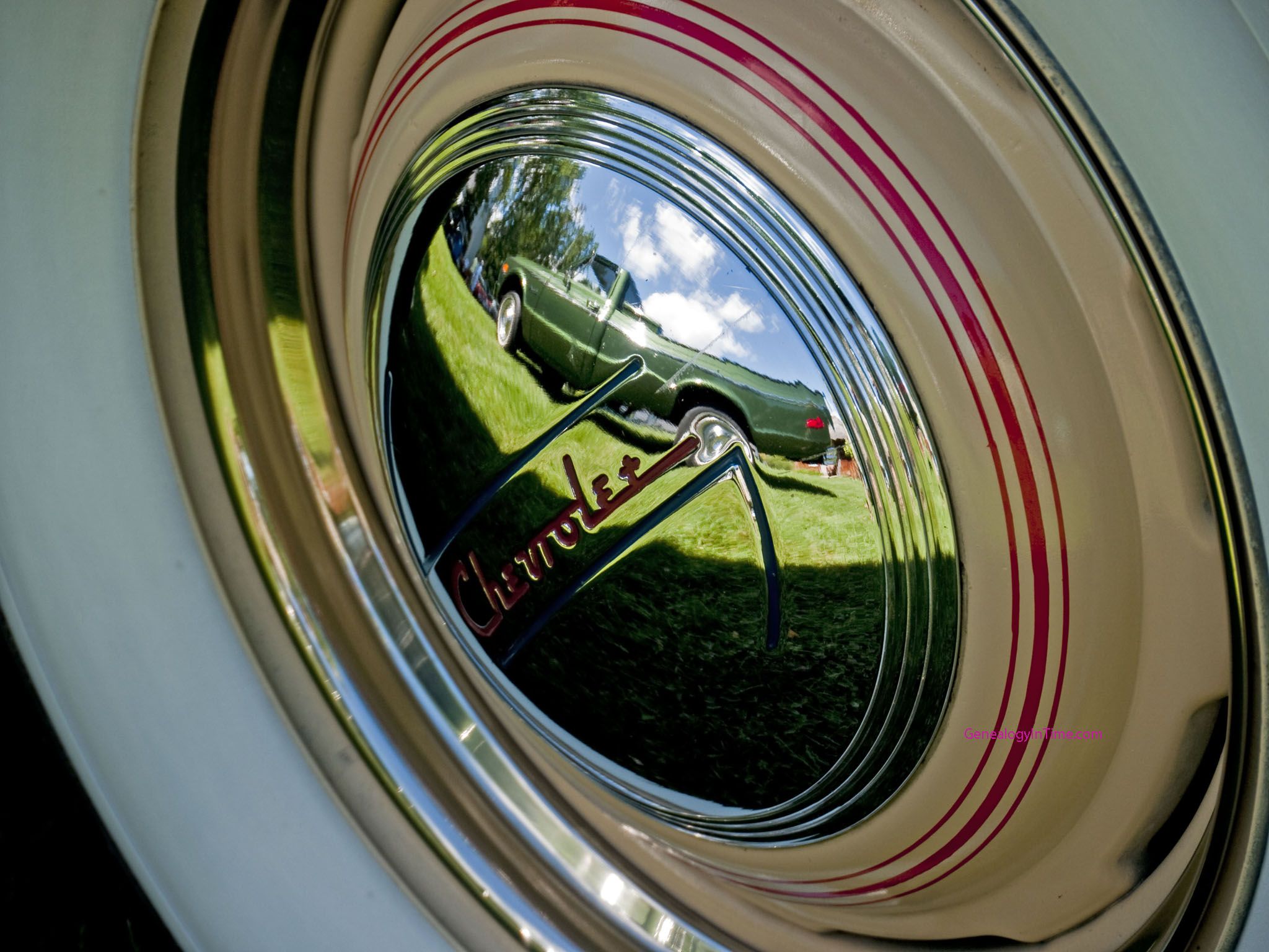 1970s Chevrolet truck reflected in a 1937 Chevrolet hubcap