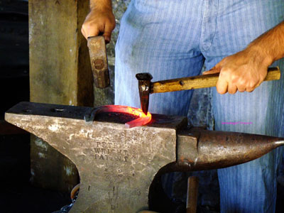blacksmith striking an anvil