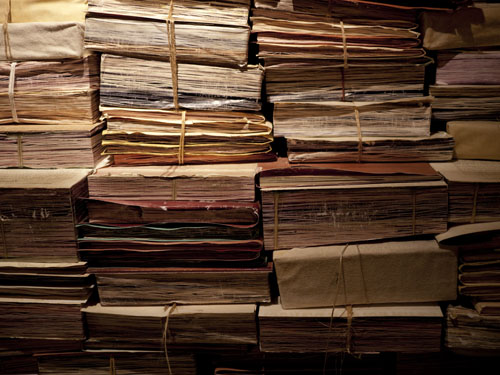 stacks of genealogy records